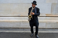 New York, NY - Busker playing the saxophone under the arch in Washington Square Park. © Stacy Walsh Rosenstock/Alamy