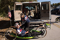 Morehead City, NC -- Paul's wife, Sally, gives him chewing gum so his mouth doesn't dry out on his ride. Quadriplegic hand cyclist Paul Kelly, 62, trains for the Boston Marathon Tuesday, March 27, 2018. (Justin Cook for The Wall Street Journal)<br /> <br /> SUMMARY:<br /> <br /> Paul Kelly, hand cyclist, Beaufort, NC Training for the Boston Marathon so we would want to shoot in March to run the week before the marathon or marathon Monday, Apriln16. Life as a quadriplegic doesn&rsquo;t keep 62-year-old Paul Kelly on the sidelines. After breaking his neck in a swimming accident in 1978, Kelly was determined to find fitness activities to maintain an active lifestyle. He discovered handcycles while watching his niece compete in the 2006 Marine Corps Marathon and was inspired to start his own marathon career to stay fit. Paul has competed in over 100 half and full marathons. On April 16, he will celebrate his 40th year of living as a quadriplegic by taking on one of the most coveted races for a marathoner -- the Boston Marathon. Kelly is among the 60 handcyclists competing in the 2018 Boston Marathon with a qualifying time of 1:26:37. Most of Paul&rsquo;s distance training takes place at Bogue Banks, which includes Atlantic Beach, Salter Path, and Emerald Isle, N.C. It&rsquo;s Nicholas Sparks worthy scenery with its marshes, waterways, inlets and small islands. Paul is particularly fond of the approach from Atlantic Beach to Bogue Banks -- it&rsquo;s via the high-rise bridge. In cold weather, Paul has to be mindful of the environment and dress in a manner that insulates his legs while also allowing his upper body to ventilate. Paul chooses to train at times of day when the temperatures are more reasonable. He uses hand warmers in his gloves, on the inside the grips on his handcycle and in the legs of his trousers.