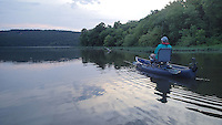 NWA Democrat-Gazette/FLIP PUTTHOFF <br /> A canoe or kayak is ideal for paddlers and anglers at Lake Sequoyah. At 400 acres, it is easy to see the whole lake by paddling. Mike McBride enjoys a quiet morning June 24, 2016 at the lake.