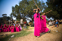 47 year old Sampat Pal Devi, founder and leader of the 10,000 strong 'Gulabi Gang' (Pink Gang), trains other women in the group to fight with lathis (traditional Indian sticks). In the badlands of Bundelkhand, one of the poorest parts of one of India's most populous states, a gang of female vigilantes have sprung up to fight the oppression of a caste-ridden, feudalistic and male dominated society. In a land where dowry demands and domestic and sexual violence are common, the 'Gulabi Gang', so called for their uniform of shocking pink saris, are picking up their lathis to fight against corruption and violence against women.