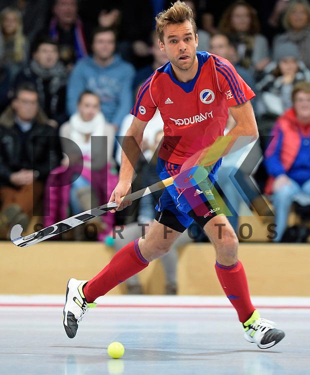 GER - Mannheim, Germany, November 28: During the 1. Bundesliga Sued Herren indoor hockey match between Mannheimer HC (red) and TG Frankenthal (white) on November 28, 2015 at Irma-Roechling-Halle in Mannheim, Germany. Final score 7-7 (HT 3-3).  Florian Woesch #25 of Mannheimer HC<br /> <br /> Foto &copy; PIX-Sportfotos *** Foto ist honorarpflichtig! *** Auf Anfrage in hoeherer Qualitaet/Aufloesung. Belegexemplar erbeten. Veroeffentlichung ausschliesslich fuer journalistisch-publizistische Zwecke. For editorial use only.
