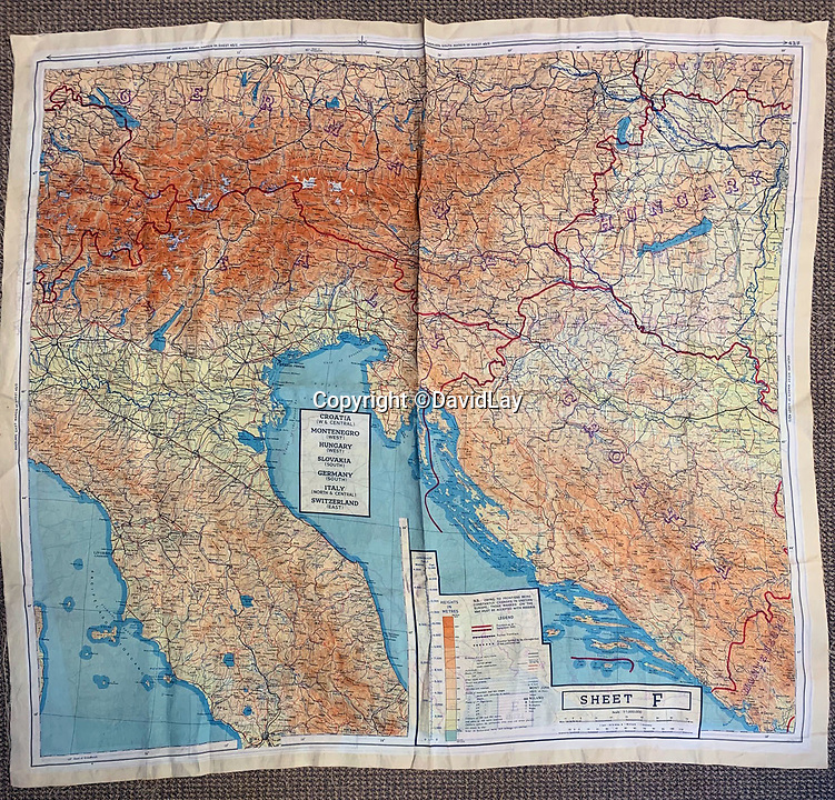 BNPS.co.uk (01202 558833)<br /> Pic:  DavidLay/BNPS<br /> <br /> One of Flight Sergeant Douglas Alexander's silk maps of southern Europe.<br /> <br /> Bomber command heroes WW2 exploits discovered in a shoebox.<br /> <br /> The personal effects of a fearless 'Tail-end Charlie' have been discovered in a shoebox - and they include a charming set of photos of his wartime service.<br /> <br /> Flight Sergeant Douglas Alexander, of 460 Squadron, took part in nearly 40 bombing raids over Germany, including the famous assault on Hitler's mountain retreat, Berchtesgaden.<br /> <br /> As a tail gunner, he sat in a tiny glass turret at the rear of Lancaster and Halifax bombers - a terribly exposed position.<br /> <br /> The shoebox, containing his bravery medals, logbooks and photos, was bought into auctioneer David Lay Frics, of Penzance, Cornwall, by his daughter.<br /> <br /> Flt Sgt Alexander's medal group includes the prestigious Distinguished Flying Medal, awarded for 'exceptional valour, courage and devotion to duty', with his photos capturing the camarederie which existed in the RAF as the airmen risked their lives on every mission to defeat Adolf Hitler.
