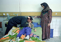 "(February 1998) Nine year old Haiman Sabri with his parents at the Saddam hospital in Baghdad. <br /> According to his doctor Haiman had a curable infection, but due to lack of anti biotics suffered life threatening complications.  <br /> Due to UN sanctions the hospital was lacking many medicines, and the civilians suffered due to lack of food as well. <br />  Former U.N. Humanitarian Coordinator in Iraq Denis Halliday estimated the resulting deaths : ""Two hundred thirty-nine thousand children 5 years old and under"" as of 1998.<br /> <br /> The sanctions against Iraq were a near-total financial and trade embargo imposed by the United Nations Security Council on the Iraqi Republic.<br /> <br /> <br /> ©Fredrik Naumann/Felix Features"