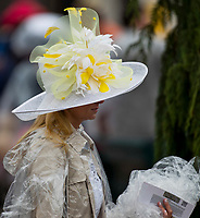 LOUISVILLE, KY - MAY 05: A woman sports a poncho and fancy hat on Kentucky Oaks Day at Churchill Downs on May 5, 2017 in Louisville, Kentucky. (Photo by Jesse Caris/Eclipse Sportswire/Getty Images)