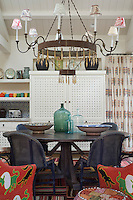 The open plan kitchen/dining area is a mixture of styles from African and Moroccan to shabby chic