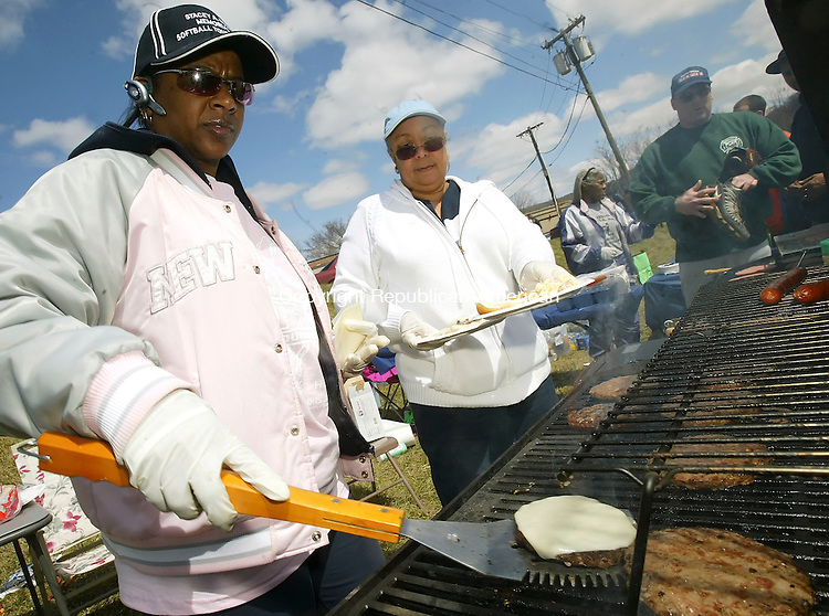 WATERBURY, CT 4/14/07- 041407BZ12- Vernecia Gatling, of Waterbury, left, and Cheryl Babbitt, of Waterbury, aunt and godmother of Stacey, cook burgers and dogs during the  &quot;Stacey A. Maia Family Day&quot; festivities at Huntingdon Park in Waterbury Saturday.  Maia was killed in an automobile accident on Chase Avenue in 2001.<br /> Jamison C. Bazinet Republican-American