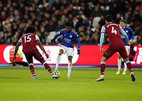 28th December 2019; London Stadium, London, England; English Premier League Football, West Ham United versus Leicester City; Demarai Gray of Leicester City is marked by Carlos Sanchez and Fabian Balbuena of West Ham United - Strictly Editorial Use Only. No use with unauthorized audio, video, data, fixture lists, club/league logos or 'live' services. Online in-match use limited to 120 images, no video emulation. No use in betting, games or single club/league/player publications