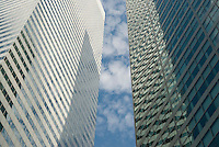 Upward View of Office Buildings and Clouds in Midtown Manhattan, New York City, New York State, USA<br /> <br /> AVAILABLE FOR LICENSING FROM GETTY IMAGES.  Please go to www.gettyimages.com and search for image # 162293657.
