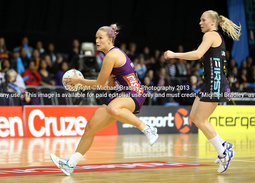 30.06.2013 Firebirds Chelsea Pitman in action during the ANZ Champs Preliminary Semi Final netball match between the Magic and Firebirds played at Claudelands Arena in Hamilton. Mandatory Photo Credit ©Michael Bradley.