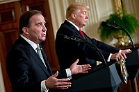 Stefan Lofven, Sweden's prime minister, speaks as U.S. President Donald Trump, right, listens during a news conference in the East Room of the White House in Washington, D.C., U.S., on Tuesday, March 6, 2018. Trump and Lofven are looking to focus on trade and investment between the two countries and ways to achieve shared defense goals. <br /> CAP/MPI/RS<br /> &copy;RS/MPI/Capital Pictures