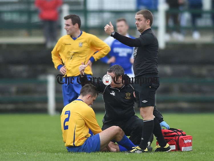 Conor Mullen of Clare is helped off injured during their FAI Oscar Traynor game against Limerick. Photograph by John Kelly.
