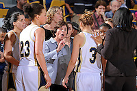 25 February 2012:  FIU Head Coach Cindy Russo speaks with players during a break in the action in the second half as the FIU Golden Panthers defeated the University of South Alabama Jaguars, 58-55 (OT), at the U.S. Century Bank Arena in Miami, Florida.