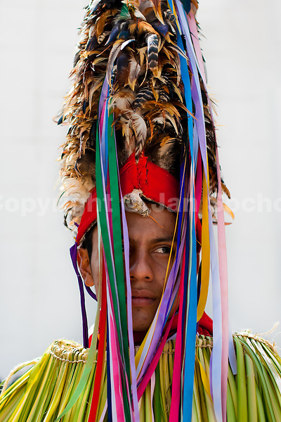 """A Cucambas dancer stands in front of the Church in the religious procession in Atanquez, Sierra Nevada, Colombia, 3 June 2010. A colorful celebration of Corpus Christi is held in the Kankuamo Indians territory every year. """"The Dance of the Devils"""" is an ancient tradition kept for centuries on the Colombia's Caribbean coast. This Christian religious event usually coincides with the summer solstice, which has always been the key point for the native cultures and for the black African slaves. Due to this confluence, the Kankuamo myths, the African animistic rites and other Pre-Columbian features have blended with the Spanish Catholic festival into a lively spectacle."""