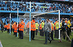 Stewards protect the goals as the fans invade the pitch during the premier league match at the Etihad Stadium, Manchester. Picture date 22nd April 2018. Picture credit should read: Simon Bellis/Sportimage