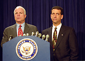 United States Senators John McCain (Republican of Arizona), left, and Russ Feingold (Democrat of Wisconsin), right, meet reporters after their proposal to overhaul the nation's campaign finance laws fell due to a Republican filibuster for the fourth straight year in the US Capitol in Washington, DC on October 19, 1999.  The bill would have banned soft money and would have allowed nonunion members to stop labor unions from spending their mandatory dues on political activities.<br /> Credit: Ron Sachs / CNP