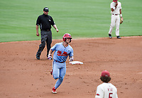 NWA Democrat-Gazette/CHARLIE KAIJO Ole Miss catcher Cooper Johnson (13) runs home during game two of the College Baseball Super Regional, Sunday, June 9, 2019 at Baum-Walker Stadium in Fayetteville. Ole Miss forces a game three with a 13-5 win over the Razorbacks