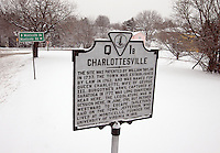 The Charlottesville Historical Signs covered with snow during an early spring in Charlottesville, VA.
