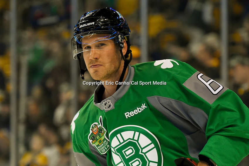 March 17, 2014 - Boston, Massachusetts , U.S. -  Boston Bruins defenseman Corey Potter (6)  dons a green jersey in celebration of Saint Patrick's Day during the warm up period before the NHL game between the Minnesota Wild and the Boston Bruins held at TD Garden in Boston Massachusetts. The Bruins defeated the Wild 4-1 at the end of regulation.  Eric Canha/CSM