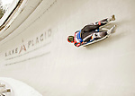 """5 December 2015: Tatjana Huefner, competing for Germany, slides through Curve 10 """"Shady"""" on her first run of the Viessmann World Cup Women's Luge at the Olympic Sports Track in Lake Placid, New York, USA. Mandatory Credit: Ed Wolfstein Photo *** RAW (NEF) Image File Available ***"""