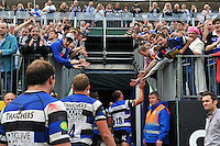 The Bath team leave the field, cheered on by supporters in the terracing. Aviva Premiership match, between Bath Rugby and Leicester Tigers on September 20, 2014 at the Recreation Ground in Bath, England. Photo by: Patrick Khachfe / Onside Images