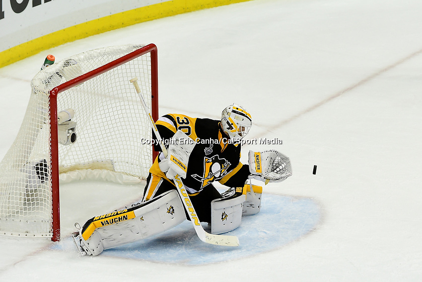 Wednesday, June 1, 2016: Pittsburgh Penguins goalie Matt Murray (30)  makes a save during game 2 of the NHL Stanley Cup Finals  between the San Jose Sharks and the Pittsburgh Penguins held at the CONSOL Energy Center in Pittsburgh Pennsylvania. The Penguins beat the Sharks in overtime 2-1 and lead the best of 7 series 2-0. Eric Canha/CSM