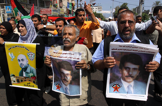 Relatives of Palestinian prisoners attend a march organized by the Red Cross calling Israel to allow residents of Gaza to visit their relatives imprisoned in Israel, on July 11, 2011 in Gaza City. Israel stopped allowing Palestinians from the Gaza Strip to visit their relatives in Israeli jails since the Islamist movement Hamas took control of the coastal territory in 2007. Photo by Mohammed Asad