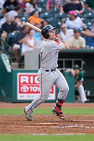 Nick Longhi (21) of the Greenville Drive follows through on his swing against the Greensboro Grasshoppers at NewBridge Bank Park on August 17, 2015 in Greensboro, North Carolina.  The Drive defeated the Grasshoppers 5-4 in 13 innings.  (Brian Westerholt/Four Seam Images)