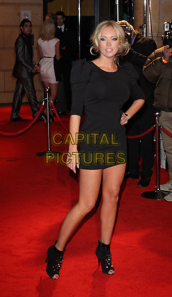 AISLEYNE HORGAN-WALLACE.Attending 'The Bounty Hunter'  UK film premiere at the Vue West End,cinema Leicester Square, London, England, UK,.11th March 2010.arrivals full length black dress hand on hip shoulder puff puffy ruched sleeve sleeves open toe shoes ankle boots booties studs studded bare legs wrist watch .CAP/ROS.©Steve Ross/Capital Pictures