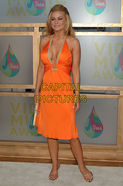 CARMEN ELECTRA.MTV Video Music Awards.Arrivals held at the American Airlines Arena,.Miami, 28th August 2005.full length orange halter neck dress plunging neckline gold trim clutch bag purse .Ref: ADM/JW.www.capitalpictures.com.sales@capitalpictures.com.© Capital Pictures.