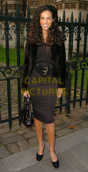 TERI SEYMOUR.Woman's Own Children of Courage Awards Departures, London..UK, United Kingdom.14th December 2005.Ref: CAN.full length black pencil skirt wide belt belted around waist leather handbag fur coat curls curly hair smiling.www.capitalpictures.com.sales@capitalpictures.com.©Capital Pictures