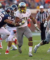Oregon running back Thomas Tyner (24)  handles the ball during the first half of the game in Charlottesville, Va. Virginia defeated Brigham Young 19-16. Photo/Andrew Shurtleff