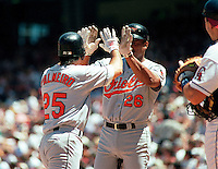 Rafael Palmeiro #25 and Bobby Bonilla #26 of the Baltimore Orioles during a 1995 season game at Anaheim Stadium in Anaheim,California.(Larry Goren/Four Seam Images)