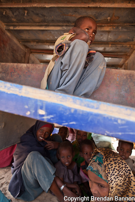 IOM movement of refugees from Liboi to Dagahaley  part of the sprawling refugge camp at Dadaab, Kenya. Refugees arriving from Somalia are transported by bus after medical screening. Prior to IOM movements of refugees people crossing from Somalia had to make the perilous ourney through the desert by foot. September 27, 2011