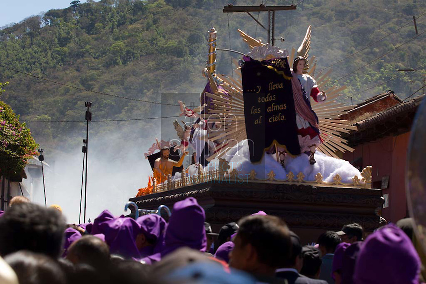 A parade of the faithful  with an anda depicting Jesus carrying the cross during the Procesión de Jesús Nazareno de La Caída from Iglesia San Bartolomé Becerra in Antigua, Guatemala. Each weekend during Lent features a procession by a different church, culminating in Semana Santa, or Holy Week, one of the largest Easter commemorations in Latin America.