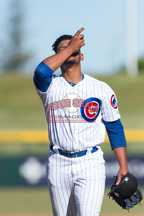 Mesa Solar Sox relief pitcher Manuel Rondon (51), of the Chicago Cubs organization, kisses his wrist as he walks off the field between innings of an Arizona Fall League game against the Surprise Saguaros at Sloan Park on November 15, 2018 in Mesa, Arizona. Mesa defeated Surprise 11-10. (Zachary Lucy/Four Seam Images)
