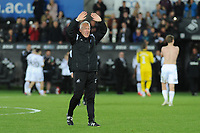 Alan Curtis, assistant coach for Swansea City applauds the fans at the final whistle during the Sky Bet Championship match between Swansea City and Derby County at the Liberty Stadium in Swansea, Wales, UK. Wednesday 01 May 2019