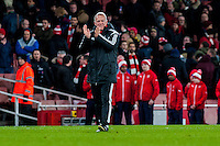 Alan Curtis, First-team coach of Swansea City applauds fans after the Barclays Premier League match between Arsenal and Swansea City at the Emirates Stadium, London, UK, Wednesday 02 March 2016