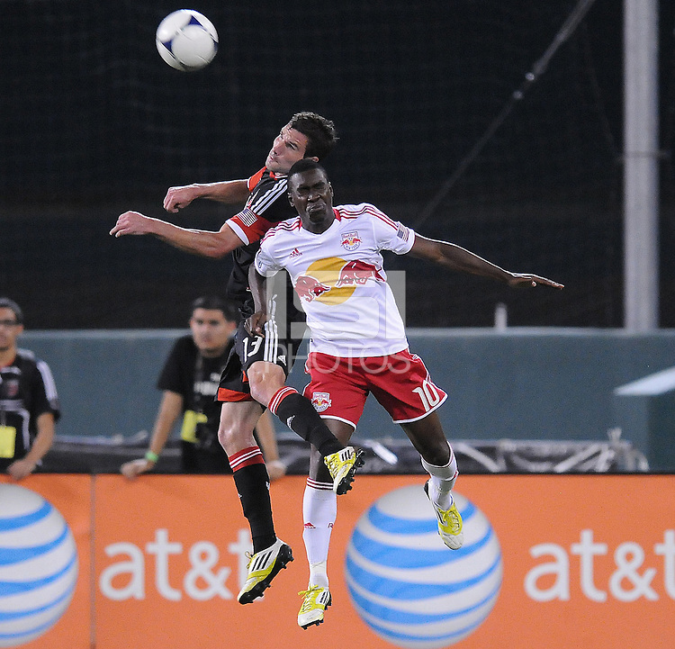 New York Red Bulls midfielder Lloyd Sam (10) heads the ball against D.C. united midfielder Chris Pontius (13) The New York Red Bulls tied D.C. United 2-2 at RFK Stadium, Wednesday August 29, 2012.