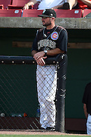 Kane County Cougars manager Mark Johnson (8) in the dugout during a game against the Quad Cities River Bandits on August 20, 2014 at Third Bank Ballpark in Geneva, Illinois.  Kane County defeated Burlington 7-3.  (Mike Janes/Four Seam Images)