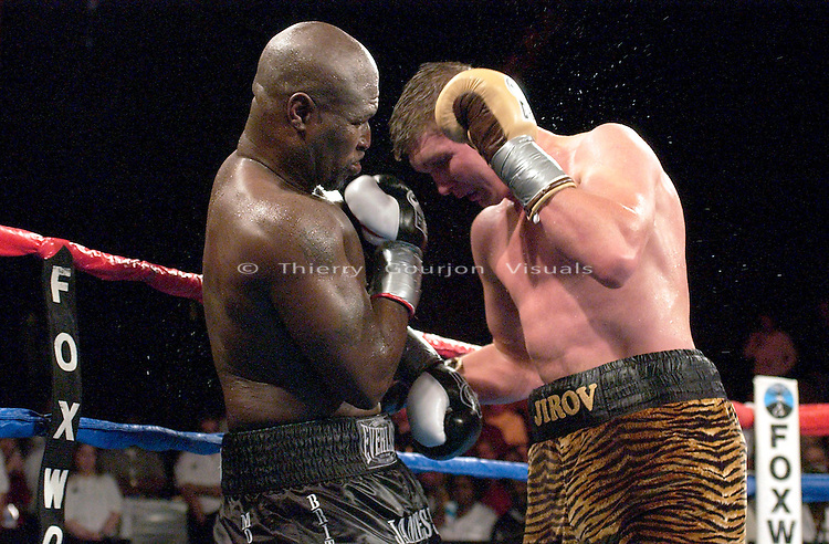 James Toney (left) on the attack against his opponent Vassiliy Jirov during the IBF Cruiserweight Championship at the Foxwoods Casino in Mashantucket, Connecticut on April 26, 2003. James Toney won the fight by Unanimous decision.