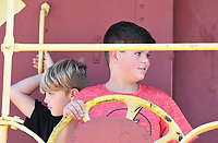 NWA Democrat-Gazette/J.T. WAMPLER Cary Tromp, 12, turns an old brake wheel while playing with his brother Ethan Tromp, 9, both of Gentry, on an old caboose in Frisco Park in downtown Rogers Monday Oct. 9, 2017. The retired caboose from the Frisco line is maintained by the Rogers Historical Museum and allows visitors to experience the railroad history of Rogers. Visitors can contact the Museum at 479-621-1154 to request the caboose be unlocked.