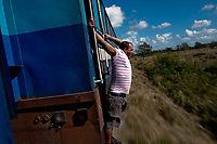 HAVANA, CUBA - FEBRUARY 8: A Cuban man stretches as he travels on a train during the trip from Havana to San Antonio de los Baños on February 8, 2018 in Cuba. Ferrocarriles de Cuba, is one of the oldest railroad around world, having opened its first route in 1837 with at least 17-mile long. Now the railway probably could cover more than 2,600 miles along the Island.  (Photo by Eliana Aponte/VIEWpress)