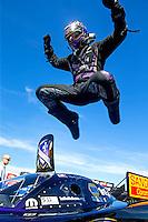 Aug 2, 2015; Sonoma, CA, USA; NHRA funny car driver Jack Beckman jumps off his car as he celebrates after winning the Sonoma Nationals at Sonoma Raceway. Mandatory Credit: Mark J. Rebilas-
