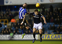 Steven Fletcher of Sheffield Wednesday beats Millwall's Shaun Hutchinson in the air and heads the ball towards goal during Millwall vs Sheffield Wednesday, Sky Bet EFL Championship Football at The Den on 12th February 2019