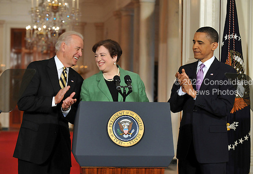 Solicitor General Elena Kagan (C) is introduced as United States President Barack Obama's (R) Supreme Court Justice nominee as he and Vice President Joe Biden (L) applaud, during a ceremony in the East Room at the White House in Washington, Monday, May 10, 2010. A vacancy in the court has opened up as current Supreme Court Justice John Paul Stevens has announced his resignation.  .Credit: Kevin Dietsch / Pool via CNP