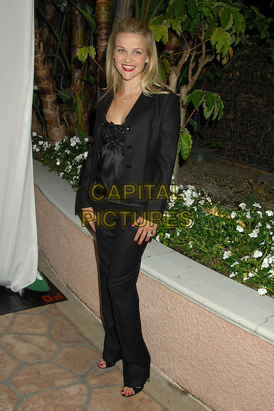 REESE WITHERSPOON.Children's Defense Fund's 16th Annual Los Angeles Beat the Odds Awards held at the Beverly Hills Hotel, Beverly Hills, California, USA..October 12th, 2006.Ref: ADM/RE.full length black trousers jacket.www.capitalpictures.com.sales@capitalpictures.com.©Russ Elliot/AdMedia/Capital Pictures.