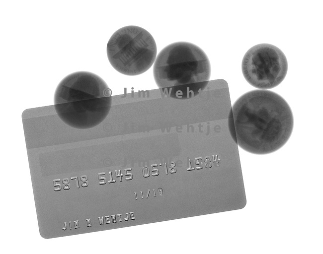 X-ray image of a credit card and coins (black on white) by Jim Wehtje, specialist in x-ray art and design images.