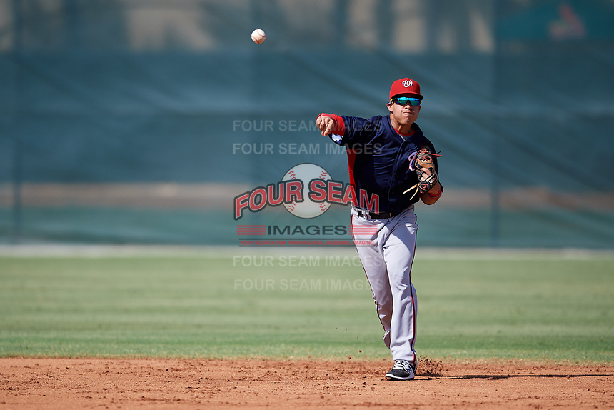 GCL Nationals shortstop Jesus Morales (2) throws to first base during a game against the GCL Cardinals on August 5, 2018 at Roger Dean Chevrolet Stadium in Jupiter, Florida.  GCL Cardinals defeated GCL Nationals 17-7.  (Mike Janes/Four Seam Images)