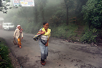 INDIA (West Bengal - Darjeeling) June 2007,Old ladies going for marketing at a  Residential area of Makaibari Tea Estate workers. Makabari has a work force of 1500. Makaibari produces the most expensive tea in the world. They produce the tea organically (without using any fertilizers or spraying pesticides)through permaculture.  Makaibari is situated at the misty foot hills of Darjeeling Himalayas - Arindam Mukherjee