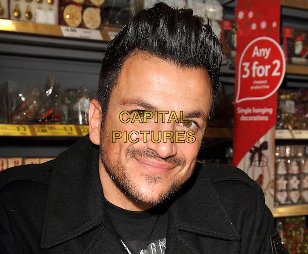 WATFORD, ENGLAND, DECEMBER 14: Peter Andre at Tesco Extra, Watford, signing his fragrances 'Forever Young' and 'Forever' and meeting fans on December 14 2013 in Watford, England.<br /> CAP/JIL<br /> &copy;Jill Mayhew/Capital Pictures